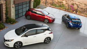 nissan leaf red white blue driveway
