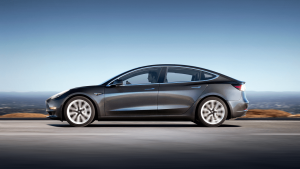 tesla model 3 grey profile road