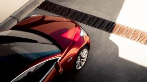 tesla model 3 red driveway